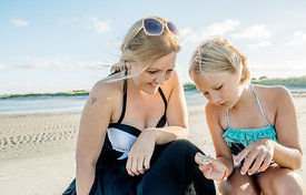 Young Nordic woman and girl on the beach