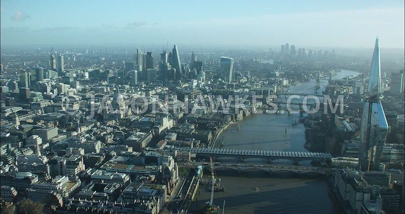 London Aerial footage, Blackfriars Bridges towards St Paul's Cathedral with River Thames.