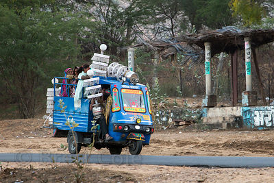 An auto rickshaw carries lanterns and workers coming from a marriage procession in Pushkar, near Kanas village, Rajasthan, India