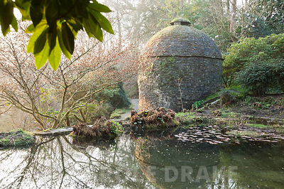 Medieval stew pond and late C16th dovecote situated at the top of the valley garden. Cotehele, Cornwall, UK