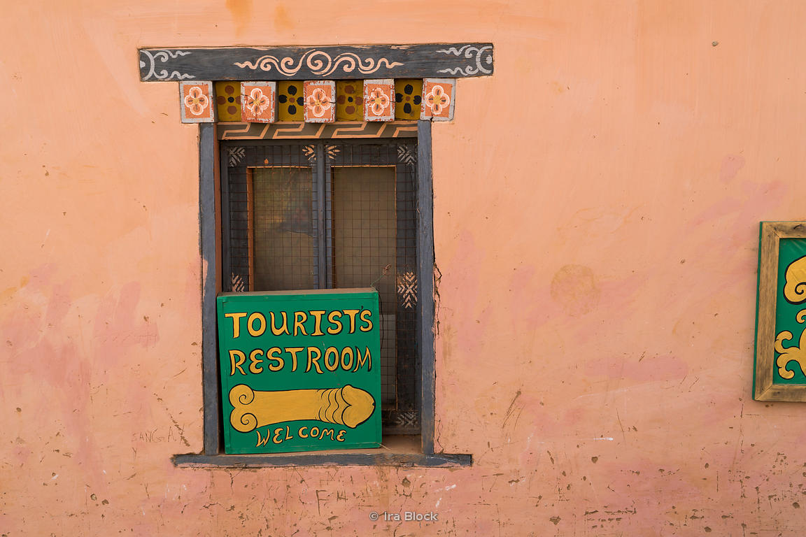 "A sign of ""Tourists Restroom"" with phallus painting near the Chimi Lhakhang Monastery or temple, in Punakha District, Bhutan..Phallus paintings in Bhutan are esoteric symbols, which have their origins in the Chimi Lhakhang monastery near Punakha, the former capital of Bhutan."