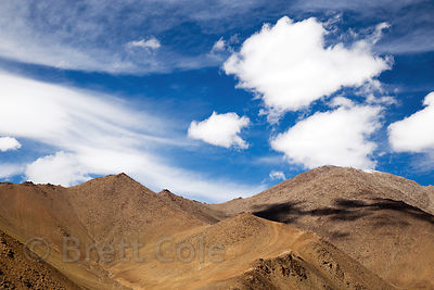 Wispy clouds over the Himalayas on the road to Khardung La, Ladakh, India