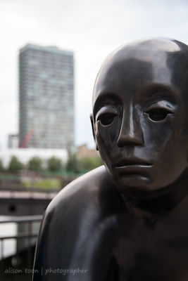 Statue of a man, Canary Wharf, London UK