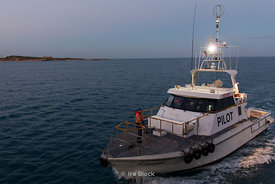 A pilot boat coming out of the harbor at Broome, Australia.
