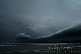 Roll cloud over mountain and bay