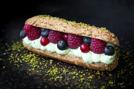 Pistachio and red berries eclair