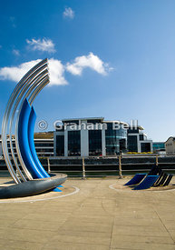 Sculpture besides River Tawe with the new SAW development in the distance, Swansea, South wales.