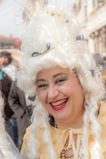 Laughing Woman Square posing in period costumes and white wig at the Venice Carnival