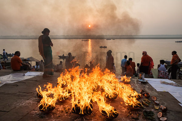 South Indians Burning Coconuts in a Sunrise Puja (Ceremony)