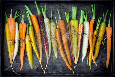 Rainbow Carrots with Olive Oil and Spices on Dark Vintage Pan