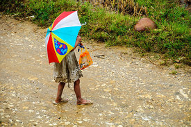 Young Village Girl with Umbrella
