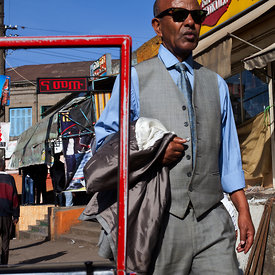 A stylishly dressed man walking through the Piazza district in Addis Ababa, Ethiopia