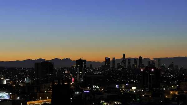 Wide Shot: Ghostly Marine Layer Backdrops A Beautiful Sunrise Over L.A.
