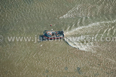 Benfleet Creek, Essex. Aerial view over boat on sea