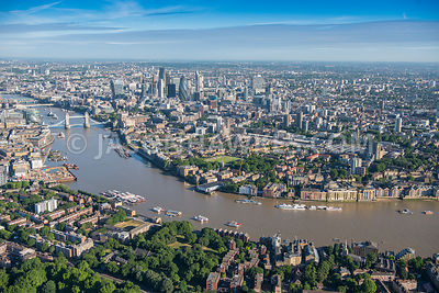 Aerial view of London, Rotherhithe and Wapping towards City of London skyline.