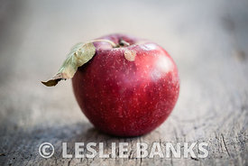 Red apple on a vintage table