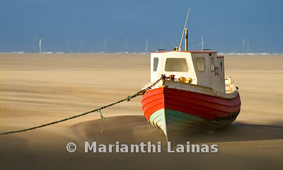 Red fishing boat at Meols beach