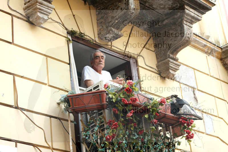 Old man on balcony