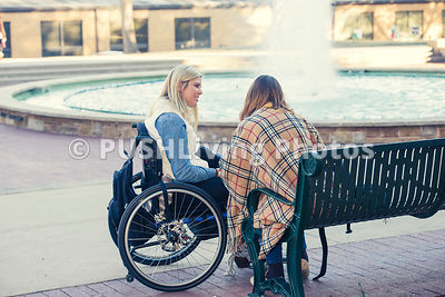 Young woman in a wheelchair at college