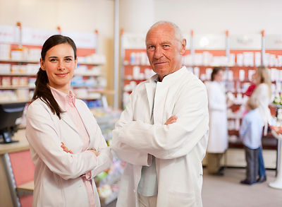 Smiling pharmacists standing in store