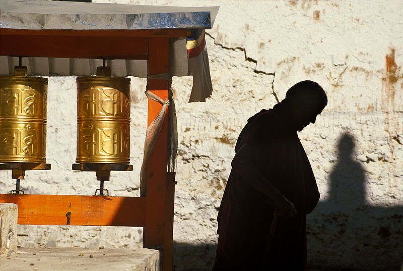 Michael Freeman Photography   Tibetan monk and prayer wheels