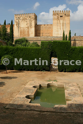 The enclosed Patio de Machuca (Machuca's Courtyard) outside the Hall of the Mexuar, Nasrid Palaces, Alhambra, looking towards Torre Quebrada (left) and Torre del Homenaje (right)