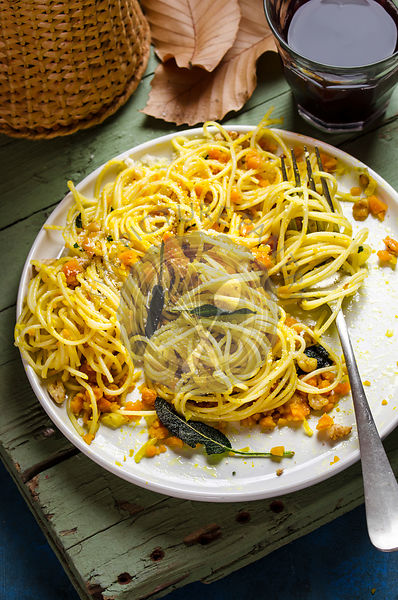 Spaghetti with pumpkin carbonara and roasted hazelnuts