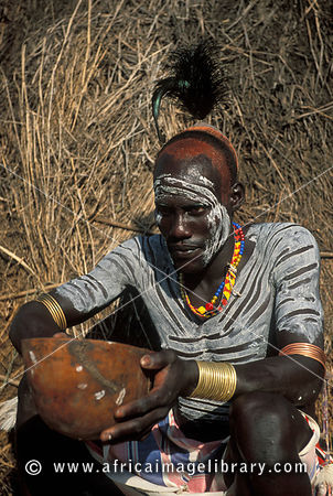 Photos and pictures of karo man with elaborate body for African body decoration
