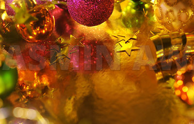 Holiday Christmas background with gold paper, decoration and lots of copy space..