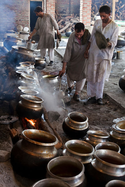 India - Srinagar - A Waza or cook in the Kashmiri traditions cooks and prepares food for a traditional Wazwan feast.