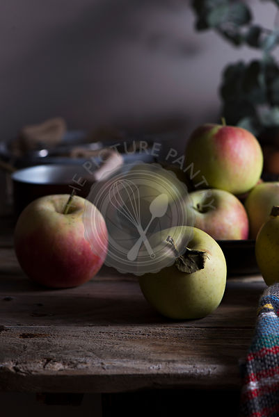 Apples on a vintage table in a kitchen