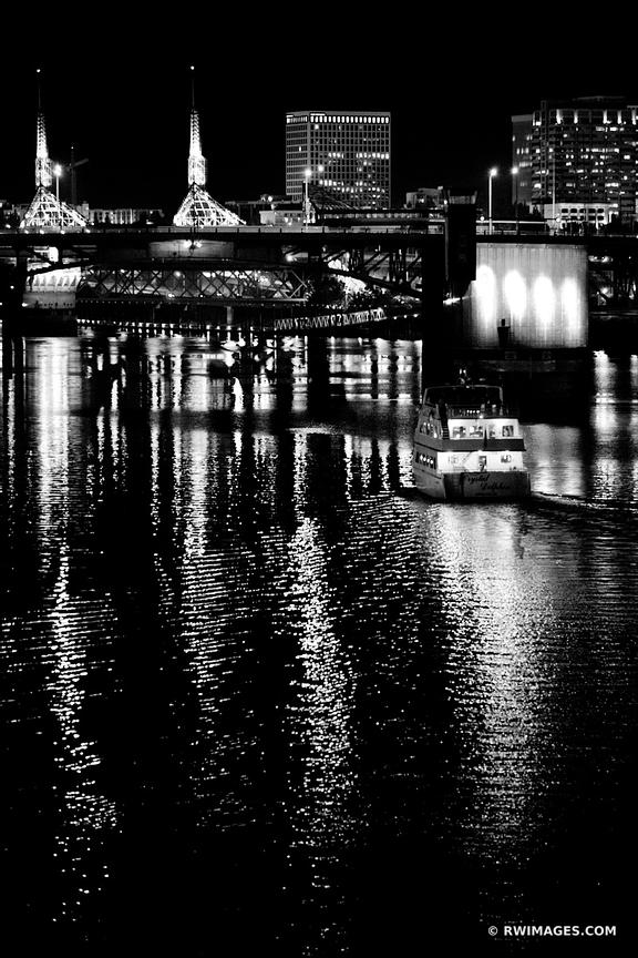 BOAT APPROACHING MORRISON BRIDGE WILLAMETTE RIVER DOWNTOWN PORTLAND OREGON AT NIGHT VERTICAL BLACK AND WHITE