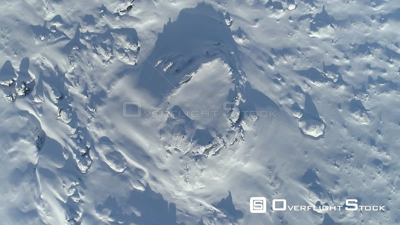 Aerial Descending Toward Snow Filled Lava Crater Iceland Day Long Shadows