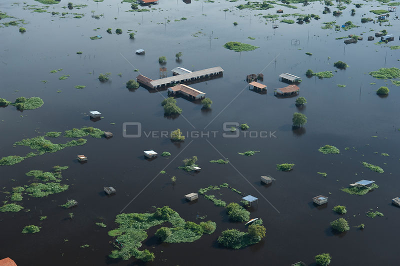 Aerial view of houses at the periphery of Trinidad city, capital of the Beni Department, during the 2008 flood of Mamoré River, Bolivia.
