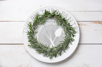 Rosemary wreath christmas appetizer with cheese and olives on plate on wooden backgrounddecoration on plate on wooden background