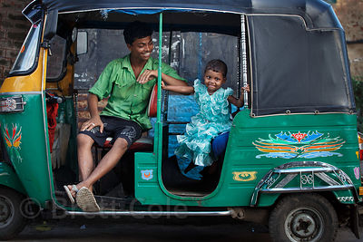 Father and daugher in an auto rickshaw, Sovabazar Ghat, Kolkata, India