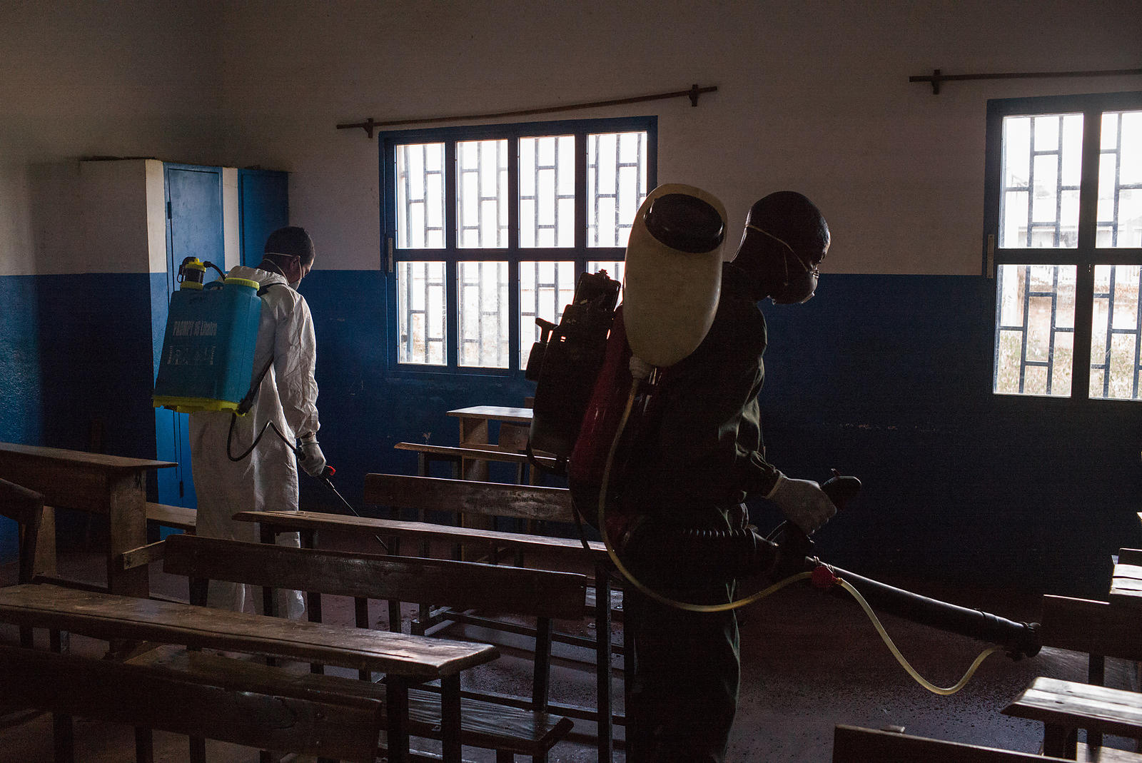 Officers from Ministry of Health spread pesticide against carriers of plague such as fleas in a primary school at Andraisoro, a district of the Antananarivo on October 2, 2017.
