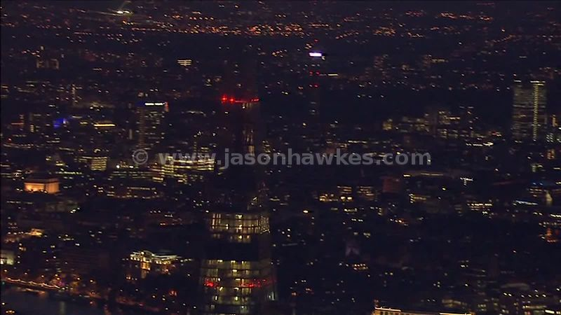 Aerial footage over The Shard at night, London, England, UK