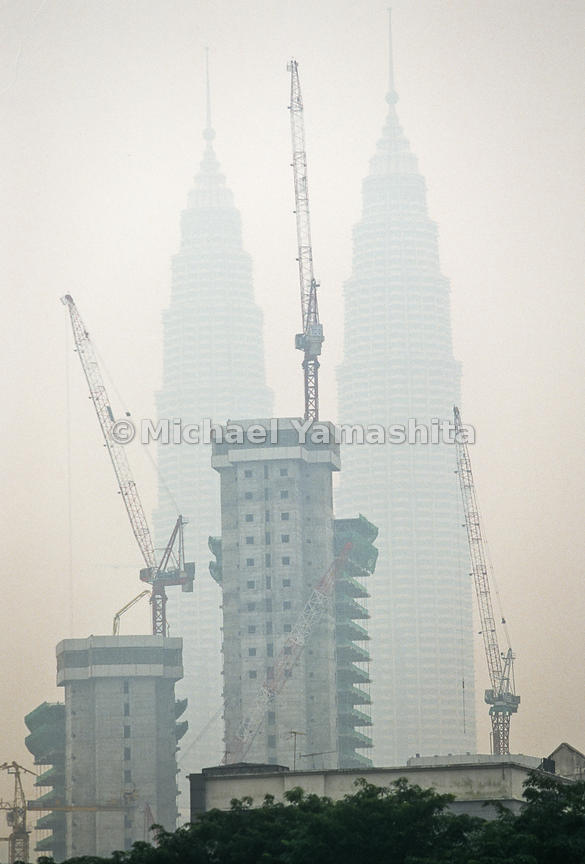 The Petrona Twin Towers can be seen with a heavy layer of smoke from the front.