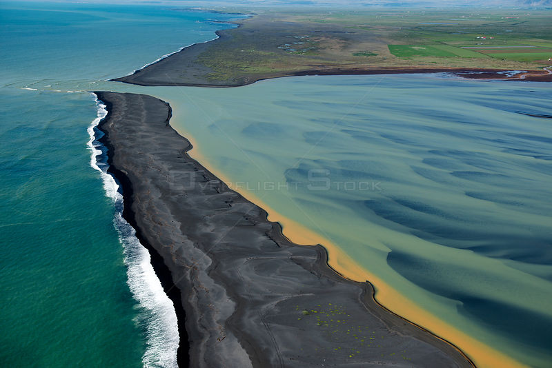 Aerial view of river delta and coast, South West Iceland, June 2014.