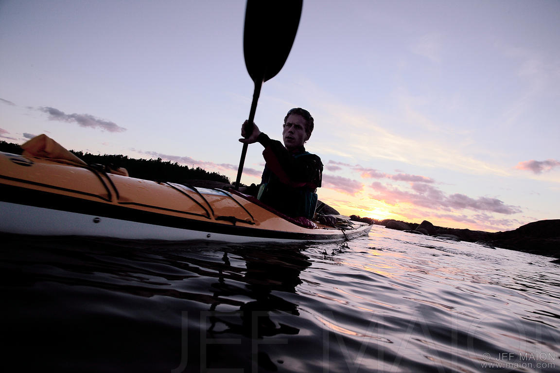 Sea kayaking at sunset