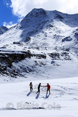Indian tourists play in the snow at Snow Point on Rohtang Pass, Manali, India