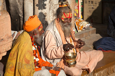 Two men dressed as sadhus (holy mena) solicit money from tourists in Jaisalmer, Rajasthan, India