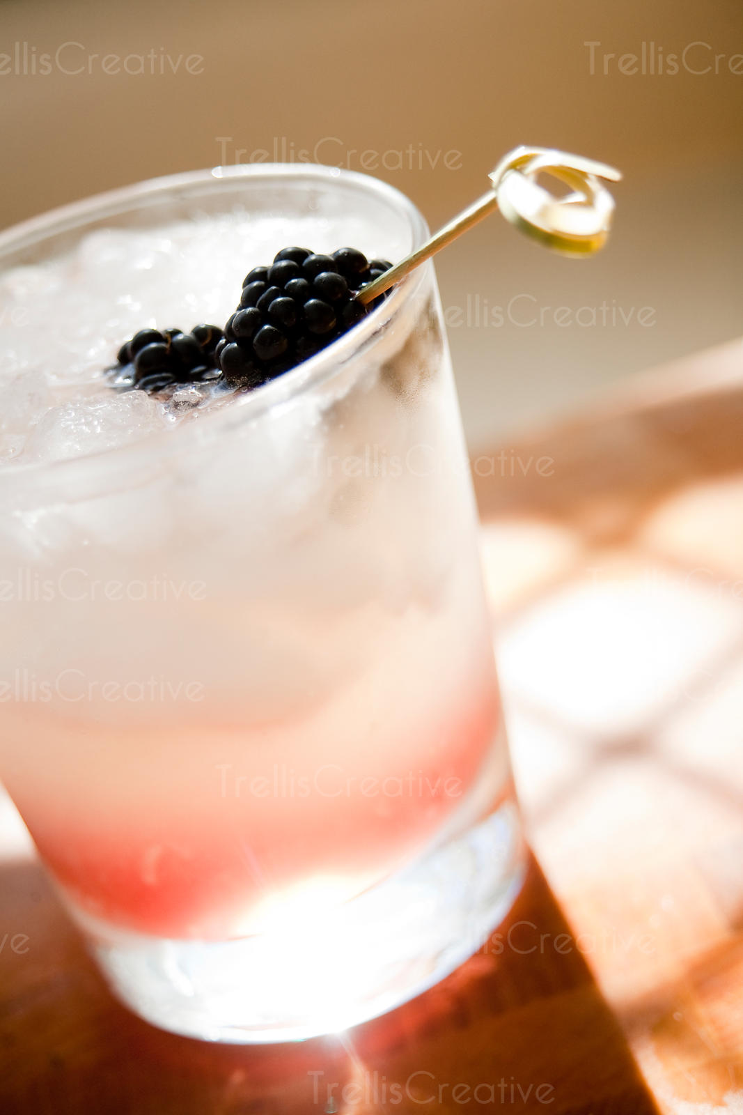 Lowball gin bramble cocktail on ice
