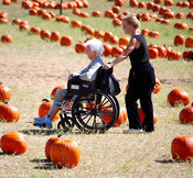 Elderly woman in a wheel chair at a pumpkin patch