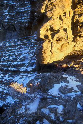 Late light on a snowy rock face at Fort Rock, eastern Oregon desert.