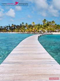 Pier to tropical island in the Caribbean