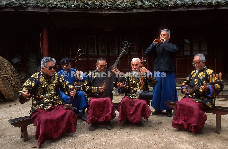 Naxi traditional band music has died out through out China and is now played for tourists. They perform nightly in town to enthusiastic crowds..Yuhu, Yunnan, China