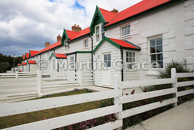 Traditional terraced cottages of Marmont Row (1854), here built in stone with corrugated iron roofs, Stanley, East Falkland, Falkland Islands