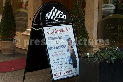 'A' Board Outside Lebanese Restaurant Advertising Music and Belly Dancer